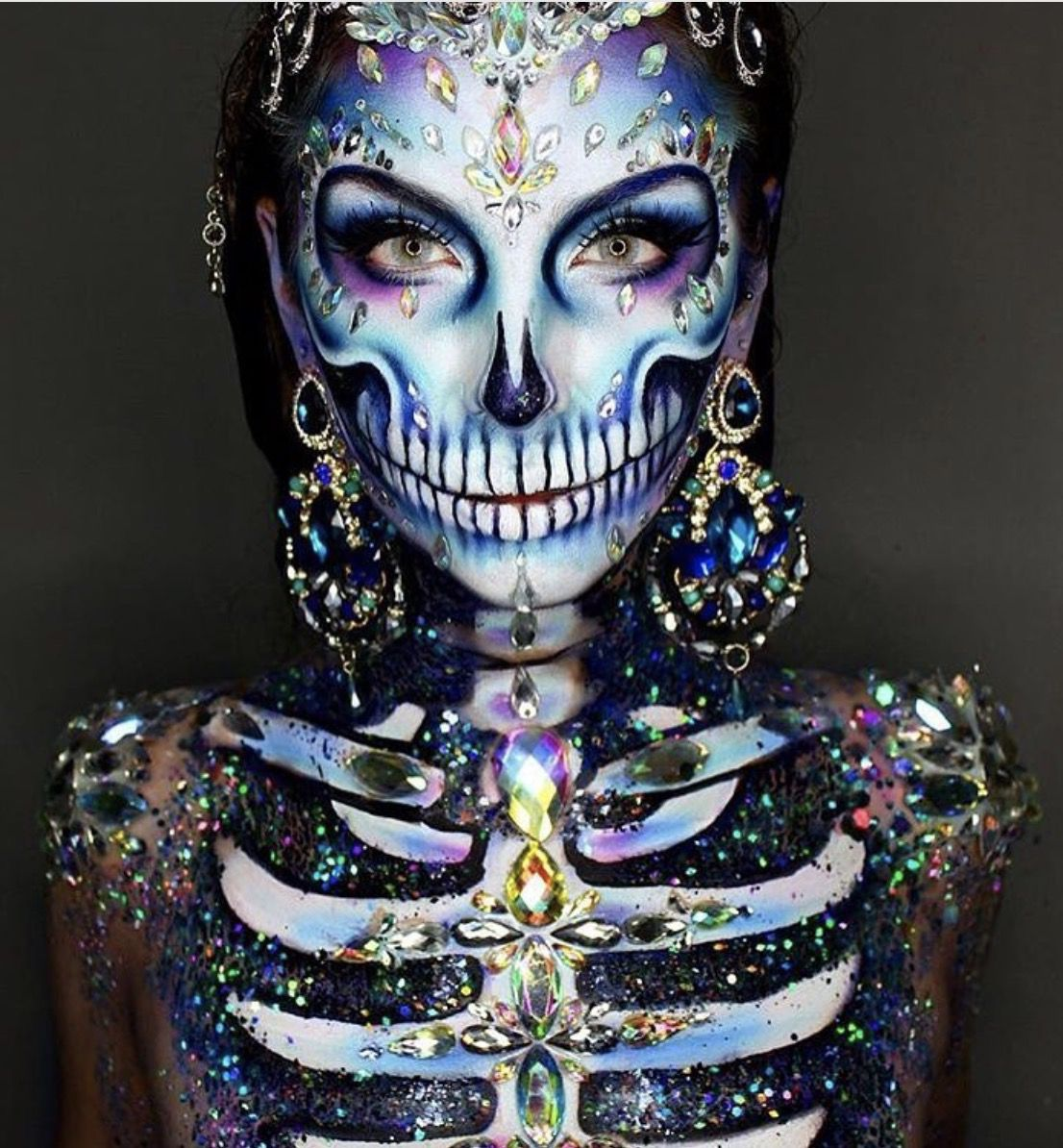 41 Most Jaw-Dropping Halloween Makeup Ideas That Are Still Pretty: Pretty Skull Makeup / Click though to see more awe inspiring pretty Halloween makeup looks, gorgeous Halloween makeup and Halloween costumes. #halloweenmakeup #halloweenmakeuppretty #halloweencostumes #halloweenmakeupinspo #prettyskullmakeup #skullmakeup