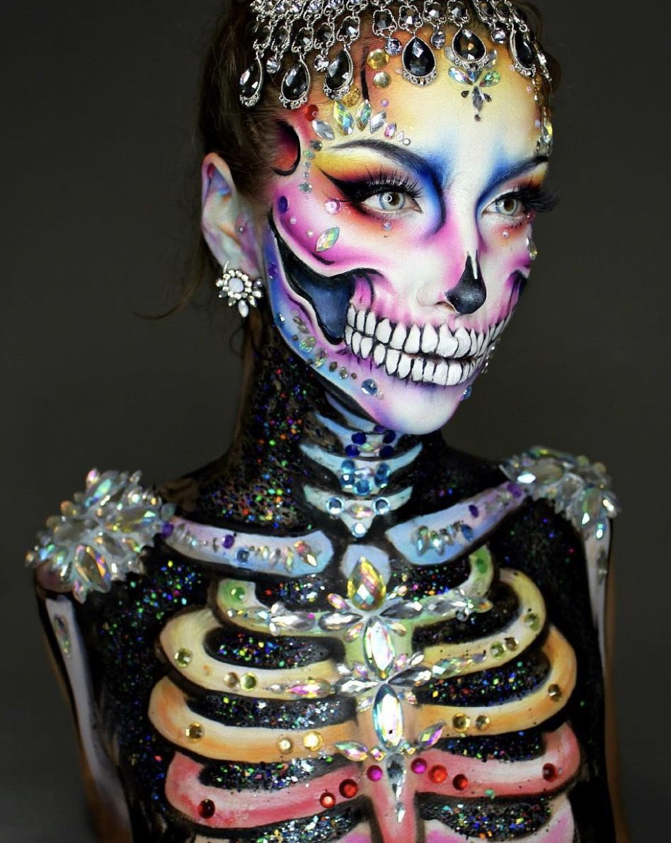 41 Most Jaw-Dropping Halloween Makeup Ideas That Are Still Pretty: Pretty Skull Makeup With Rhinestones / Click though to see more awe inspiring pretty Halloween makeup looks, gorgeous Halloween makeup and Halloween costumes. #halloweenmakeup #halloweenmakeuppretty #halloweencostumes #halloweenmakeupinspo #prettyskullmakeup #skullmakeup