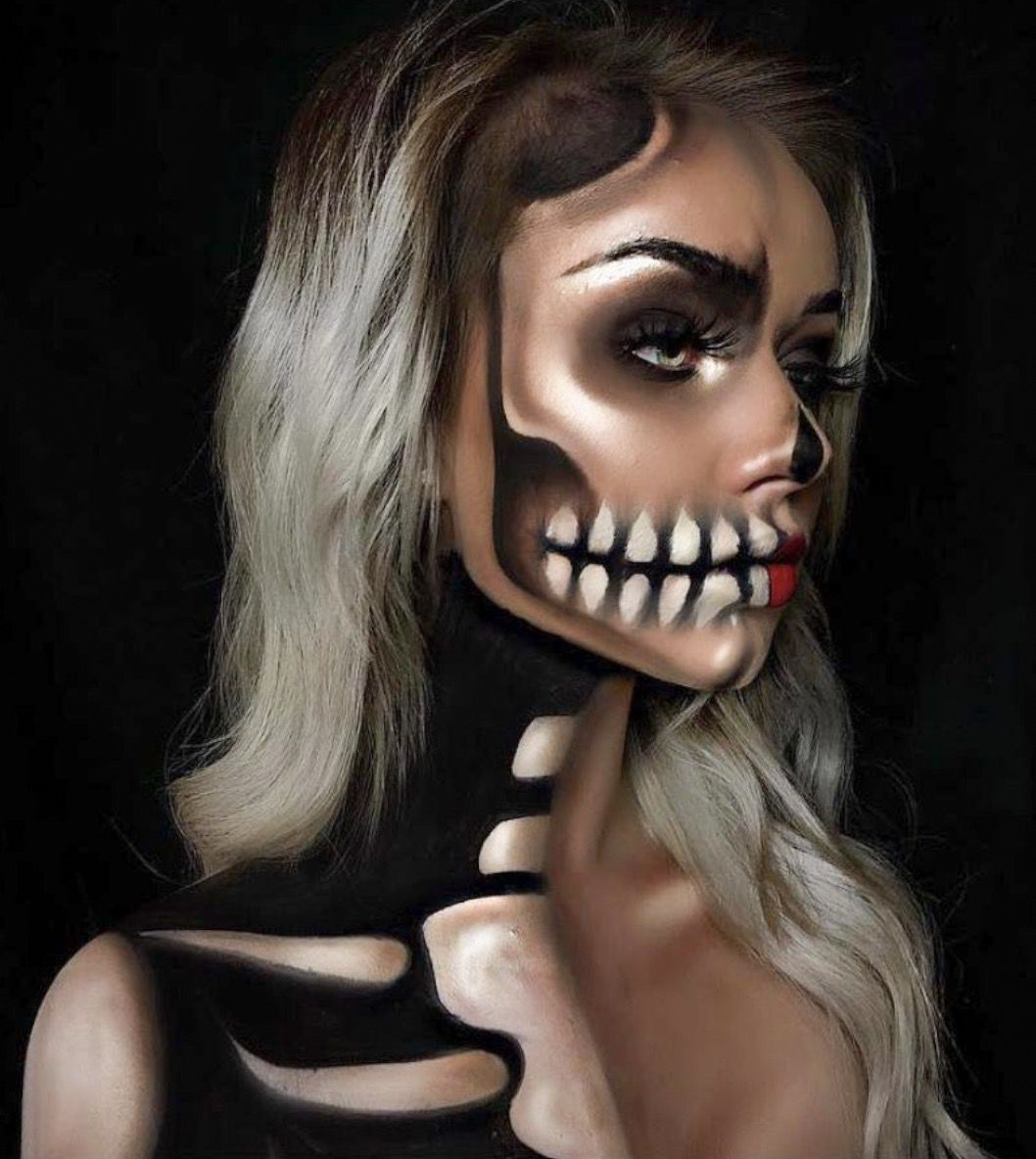 41 Most Jaw-Dropping Halloween Makeup Ideas That Are Still Pretty: Pretty Skull Makeup That Glows / Click though to see more awe inspiring pretty Halloween makeup looks, gorgeous Halloween makeup and Halloween costumes. #halloweenmakeup #halloweenmakeuppretty #halloweencostumes #halloweenmakeupinspo #prettyskullmakeup #skullmakeup
